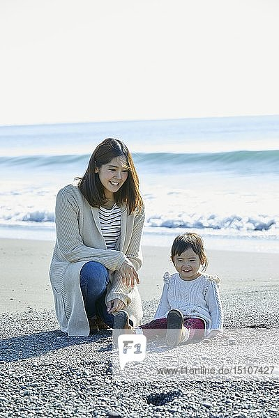 Japanese kid with mother at the beach