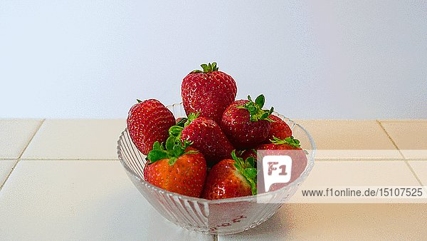 Bowl of Strawberries  One Strawberry Opening its Eyes and Looks Around to see What's going on