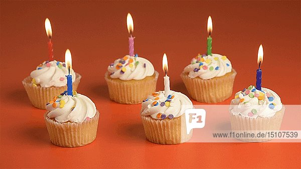 Six Cupcakes with Lit Candles