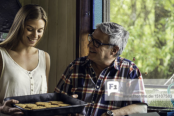 Father talking with his daughter at home