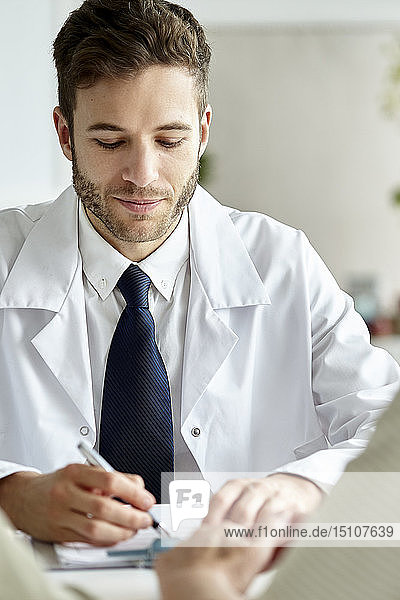 Doctor writing prescription in clinic