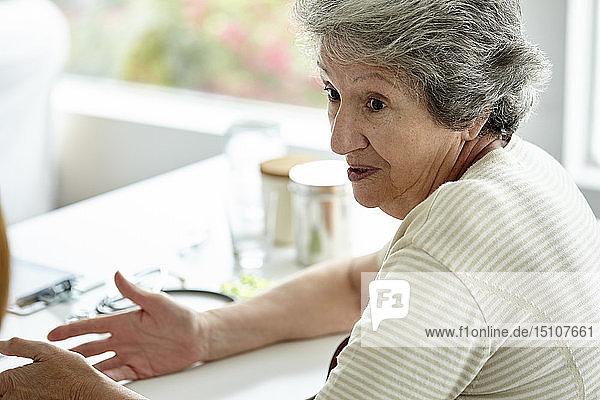 Senior woman sitting in clinic