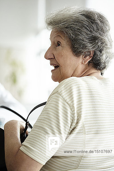 Senior woman sitting in the clinic