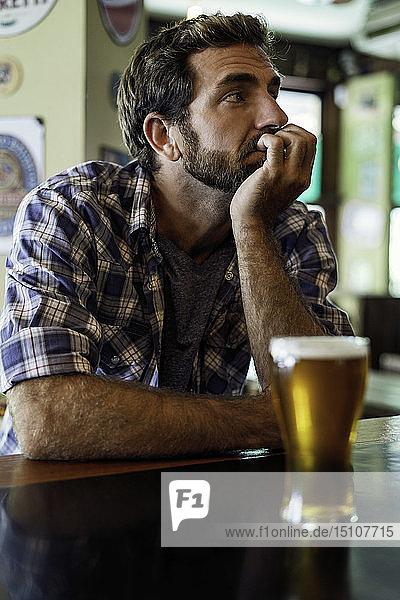 Man sitting in beer bar
