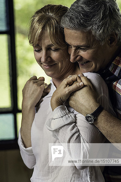 Couple embracing at home