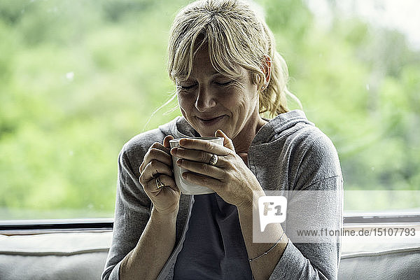 Mature woman having coffee