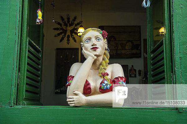 Traditional puppet in a window in Sao Joao del Rei,  Minas Gerais