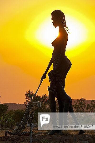 Giant statue by an Aboriginal artist in the backlight  Northern Territory  Australia