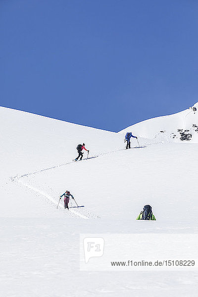 Austria,  Tyrol,  between Ischgl and Galtuer,  ski tourers climbing up a mountain in winter