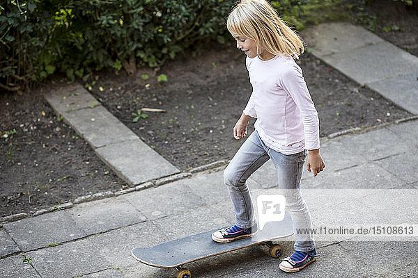 Smiling little girl with skateboard