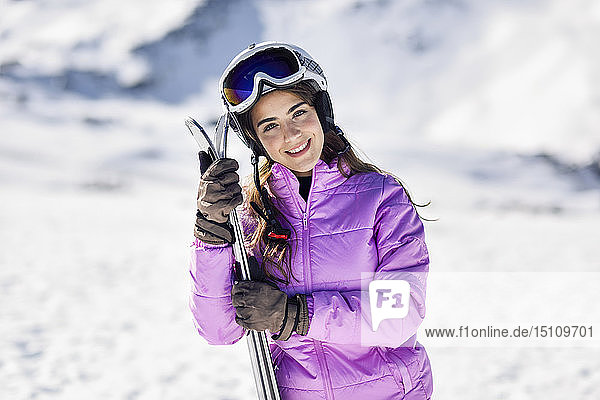 Portrait of smiling woman in ski clothes  Sierra Nevada  Andalusia  Spain
