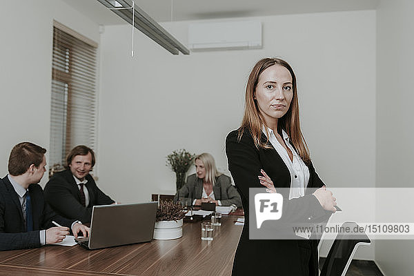 Portrait of confident young businesswoman on a meeting in conference room