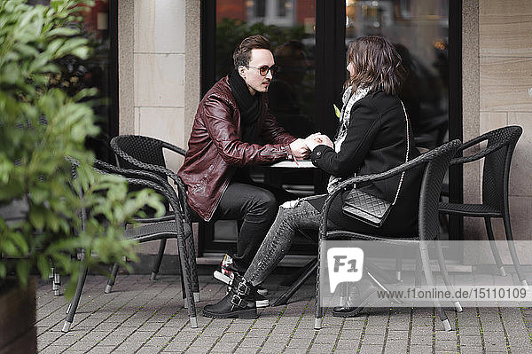 Young couple at a pavement cafe in the city