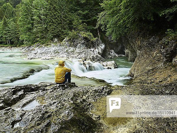 Austria  Tyrol  Brandenberg  hiker sitting on riverside of Brandenberger Ache
