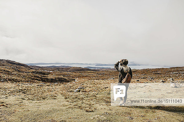 UK  Scotland  Highland  Applecross  rear view of young woman in rural landscape