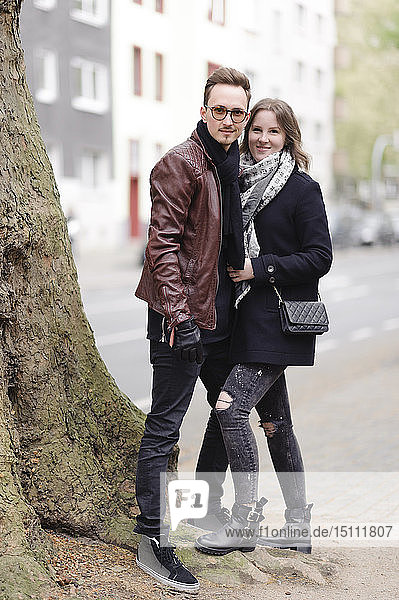 Portrait of stylish young couple in the city