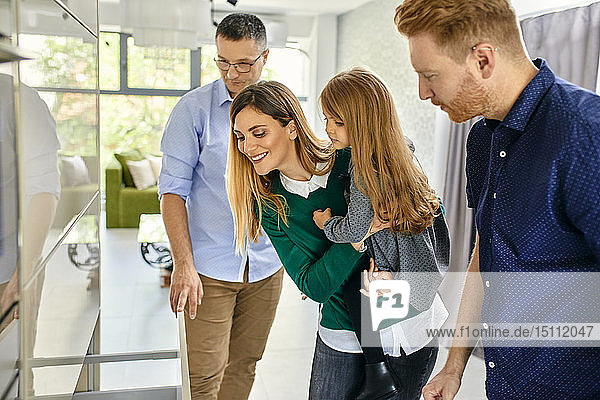Family shopping for a new kitchen in showroom