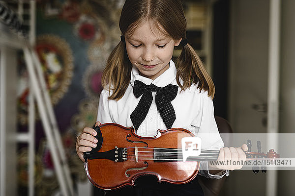 Girl looking at her violin