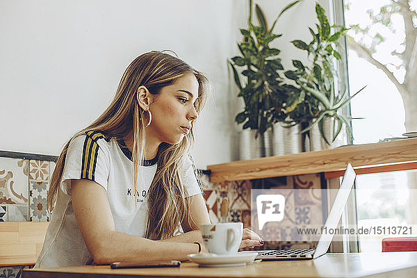 Young woman using the laptop in cafe