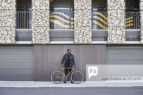 Man with bike walking on pavement