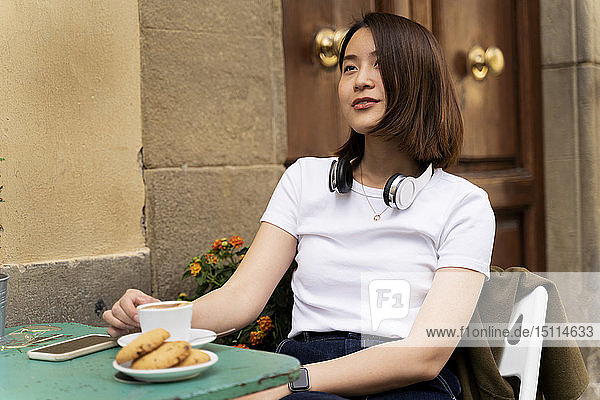 Italy  Florence  young woman at an outdoor cafe