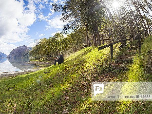Italy  Lombardy  senior man having a break at Lake Idro