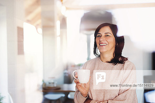 Mature woman drinking a cup of coffee