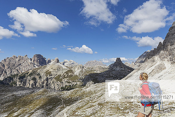 Female hiker looking at view  Tre Cime di Lavaredo Area  Nature Park Tre Cime  Unesco World Heritage Natural Site  Sexten Dolomites  Italy