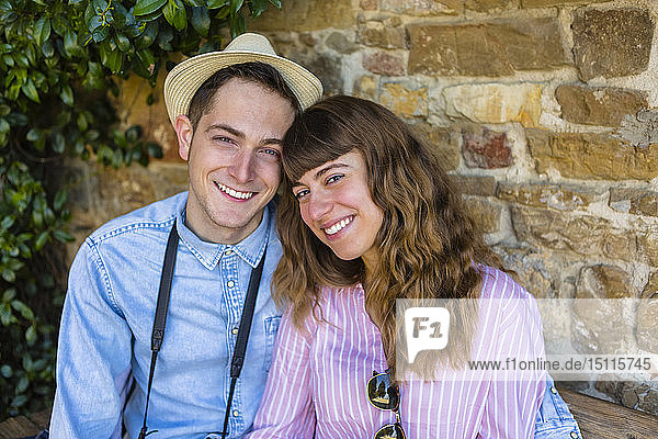 Young couple on a city break  sitting on a bench  taking a break