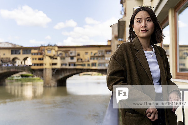Italy  Florence  young tourist woman at Ponte Vecchio