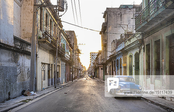 Parked blue vintage car on empty street at evening twilight  Havana  Cuba