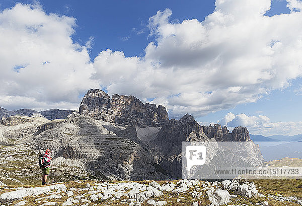 Hiker on hiking trail  Tre Cime di Lavaredo Aera  Nature Park Tre Cime  Unesco World Heritage Natural Site  Sexten Dolomites  Italy