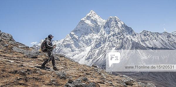 Nepal  Solo Khumbu  Everest  Mountaineer walking near Dingboche