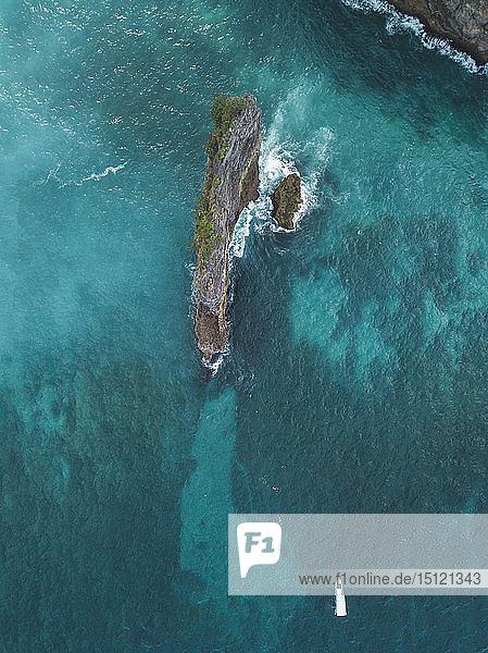 People snorkeling in ocean  Nusa Penida island  Bali  Indonesia