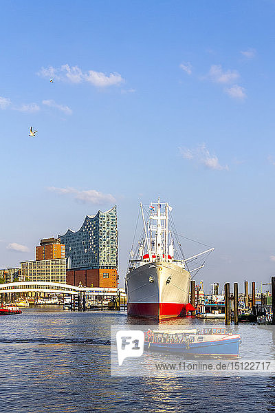 View to Elbe Philharmonic Hall with ship and boats in the foreground  Hamburg  Germany