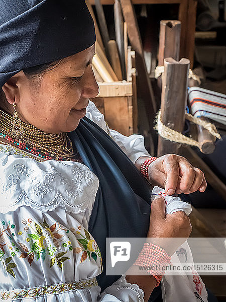 Indigenous woman doing traditional embroidery  Otavalo  Ecuador  South America