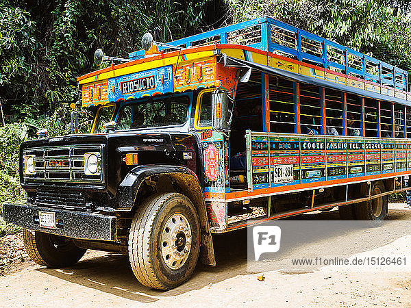 Brightly painted chivas  common transport in rural Antioquia  near Jardin  Antioquia  Colombia  South America