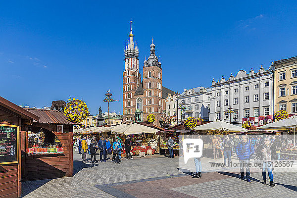 Market scene in the main square  Rynek Glowny  in the medieval old town  UNESCO World Heritage Site  in Krakow  Poland  Europe