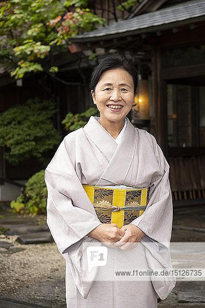 A hostess dressed in a kimono at the Yatsusankan ryokan in Hida Furukawa  Gifu Prefecture  Honshu  Japan  Asia