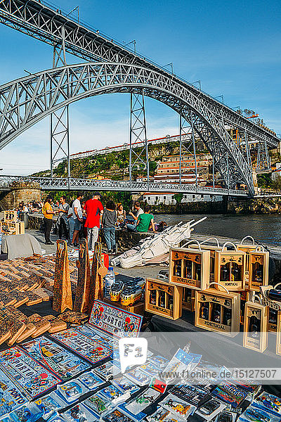 Souvenirs for sale at Cais Ribeira overlooking the Dom Luis I bridge in Porto  UNESCO World Heritage Site  Portugal  Europe
