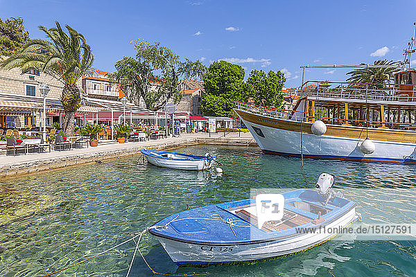 View of harbourside restaurants in Cavtat on the Adriatic Sea  Cavtat  Dubrovnik Riviera  Croatia  Europe
