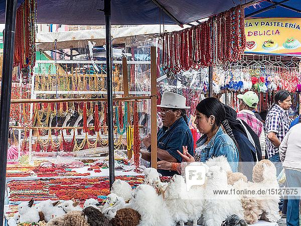 Goods for sale  market  Plaza de los Ponchos  Otavalo  Ecuador  South America