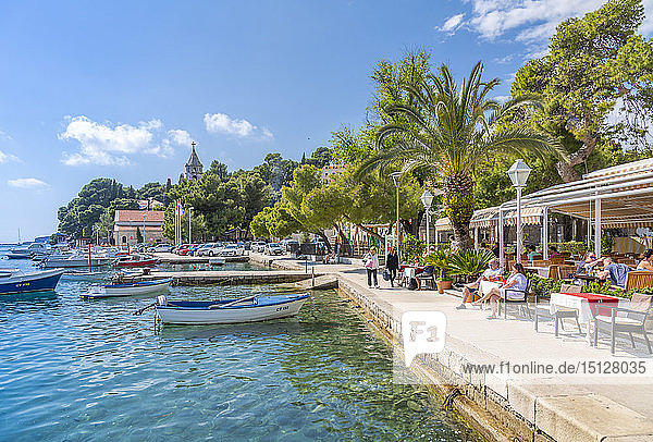 View of boats and old town restaurants in Cavtat on the Adriatic Sea  Cavtat  Dubrovnik Riviera  Croatia  Europe