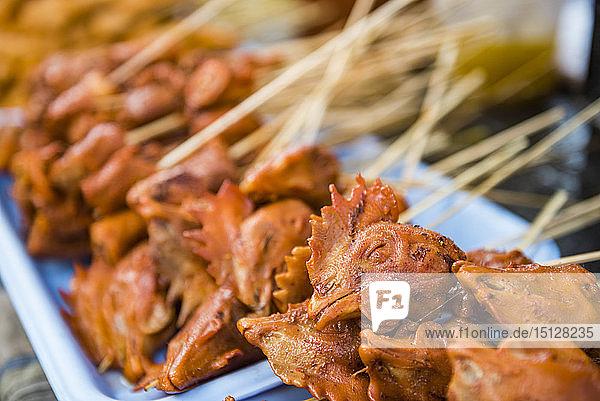 Chicken heads for sale at Ywama Market  Inle Lake  Shan State  Myanmar (Burma)