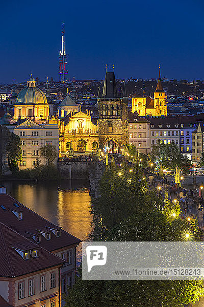 View from the Lesser Town Bridge Tower over Charles Bridge and the old town at dusk  UNESCO World Heritage Site  Prague  Bohemia  Czech Republic  Europe