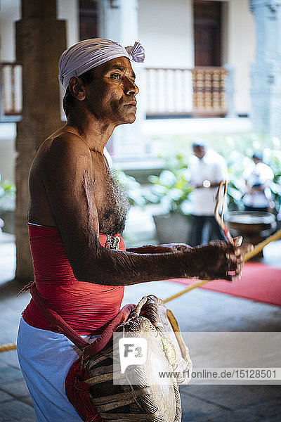 Drummer during Puja  Temple of the Sacred Tooth Relic  Kandy  Central Province  Sri Lanka  Asia