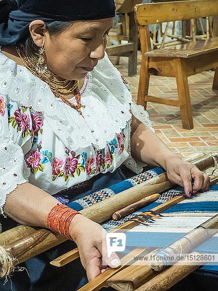 Indigenous woman weaving with backstrap loom  Otavalo  Ecuador  South America