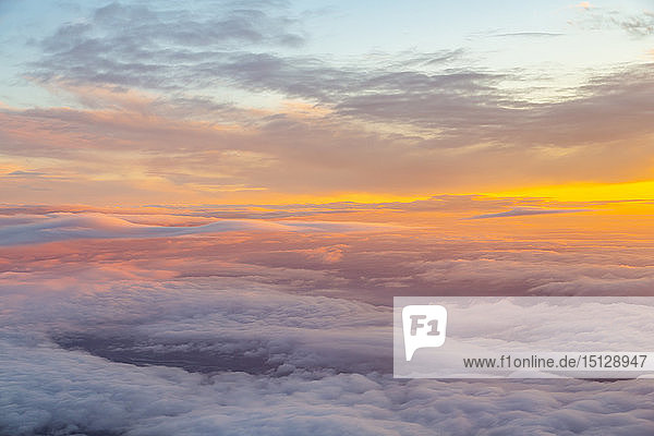 Generic view from airplane window of sunrise over England  United Kingdom  Europe