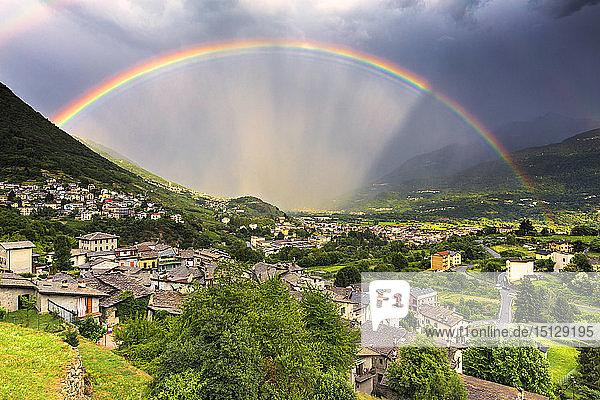Rainbow above the valley  Valtellina  Lombardy  Italy  Europe