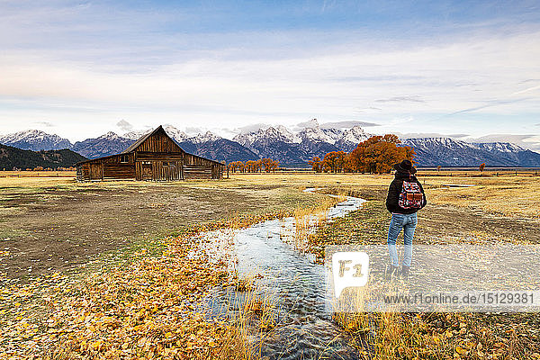 Woman at Mormon Row and Teton Range  Grand Teton National Park  Wyoming  United States of America  North America